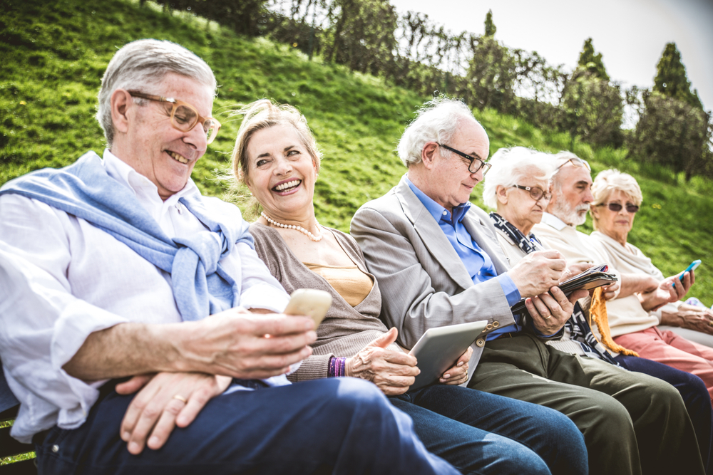 Group,Of,Senior,People,Resting,In,A,Park,-,Mature